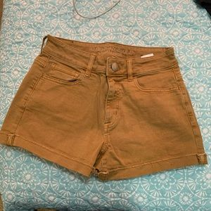 Mustard yellow/ tan shorts